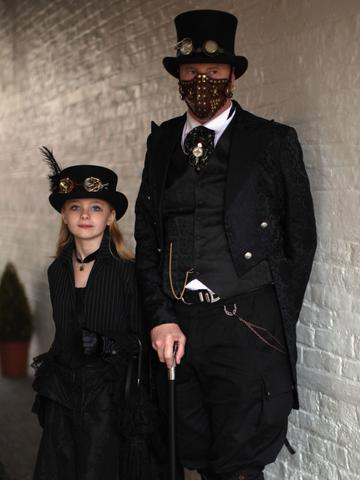 black steampunk outfit a man and a girl with steampunk goggles