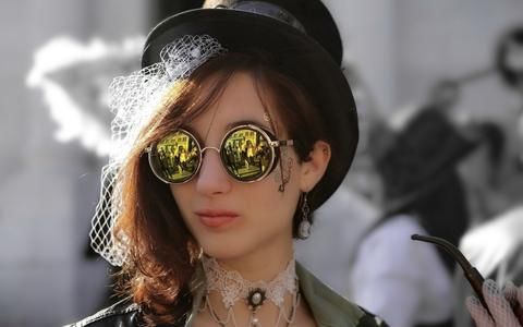 women with steampunk sunglasses and hat steampunk outfit